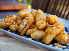 Honey Struffoli with Orange and Pignoli recipe from Guy Fieri via Food Network Food Tv Network, Food Network Recipes, Cooking Recipes, Profiteroles, Scones, Guy's Big Bite, Delicious Desserts, Dessert Recipes, Vegetarian Recipes