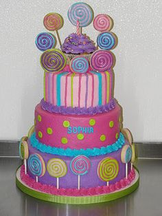 A lollipop cake for a first birthday. The lollipops are actually decorated cookies.