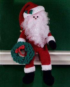 Santa clause shelf sitter with Christmas wreath