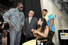 Mayor and Red Sox Star David Ortiz meeting with Thania Lee Cotto, who was seriously injured in a drive by shooting several weeks ago in Cambridge, during this morning's MLK Summer Scholars event at Boston University.