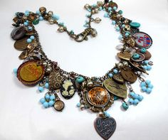 Found items bib necklace with lots of charm elements from http://www.bsueboutiques.com   Made by Brenda Sue Lansdowne