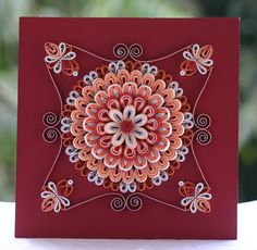 Red shaded mandala - quilling art