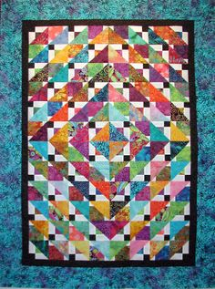 Gorgeous Disappearing 9-patch on point with batiks - Kerry's Quilting Home Page