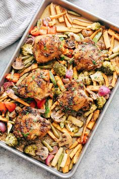 Sheet Pan Honey Balsamic Chicken Thighs with Veggies tray with broccoli, peppers, onions, sweet potatoes, carrots, mushrooms and broccoli