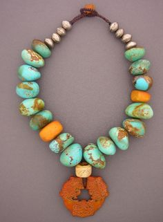 Dorje Design | Huge turquoise nuggets from the Kingman Mine in Arizona,  antique Moroccan amber, a bead from Papua New Guinea,  and Tuareg silver beads combine in this great necklace | http://dorjedesigns.com/
