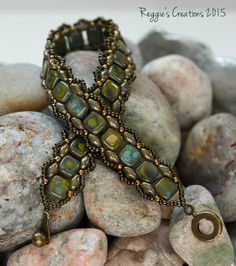 This is a new design for me using the Toying for Tilas tutorial from Wescott Jewelry.  Instead of Tilas I used Czechmate 6mm Tiles.  The color combination Picasso Opaque Olive and Opaque Olive Bronze Picasso is quite striking.  I really like this design and will be creating more for sure.