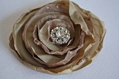 Fabric flower for crafts & accessories. Cute! Would like to use vintage fabric & jewelry instead of pre-made scrapbook supplies.
