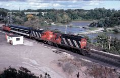 Canadian National Geeps 4560 and 4577 at Bayview Junction (Hamilton), ON, 1981 with business car and caboose.