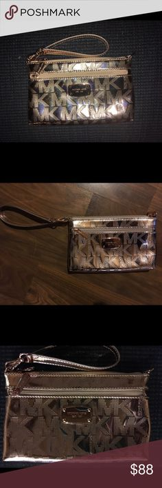 Michael Kors Wristlet Excellent condition- only used once or twice! Rose gold (metallic) large wristlet. MICHAEL Michael Kors Bags Clutches & Wristlets