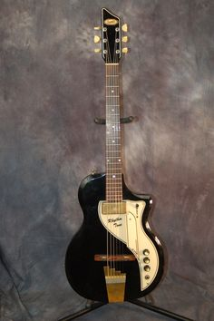 1958 Supro Rhythm Tone Guitar. For sale in my eBay Store..give me a call..515-864-6136