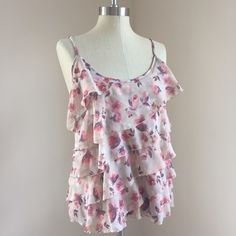 LC Floral tank Beautiful floral tiered ruffle tank by Lauren Conrad. It is a size large, it fits me very loose. Could probably fit a medium, lovely for summer with shorts and sandals! ☀️   No trades No ️aypal No Merc ✅Posh Rules ✅Use Offer Button ✅Bundle for 15% off  Instagram @BeThriftyChic LC Lauren Conrad Tops Tank Tops