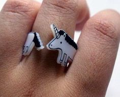 awesome rings by greenmot on etsy, there's a cat, crocodile, hedgehog and cat too!!