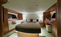Prestige 620 S: Notice how the deck is raised around the master berth. The desk at the right is also a vanity. The sofa to the left gives a great view out the hull side window.