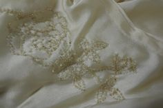 Floral beading design on a 1920s wedding dress. Collection: Royal Pump Room/Harrogate Museum.