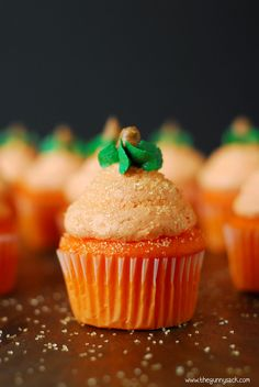 Pumpkin cupcakes for Halloween with light, fluffy buttercream frosting. They don't have pumpkin in them, but they have a buttercream pumpkin on top!