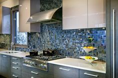 Beautiful blue mosaic glass tile backsplash for the kitchen