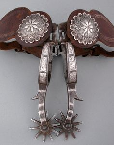 "Mike Morales, squashed ""M"" marked, silver inlaid California Spurs with 2 1/2"" - 10 point rowels, early 2-piece leathers mounted with Ed Fields scalloped silver conchos. Pictured as Pattern #63 in the Morales Cat. Fine cond, c. 1915"