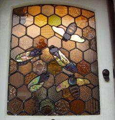 Simone Kay Stained Glass How cute is THIS??? framed with a cabinet door. Great idea for a workshop window.
