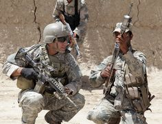 Side by side  A U.S. Army soldier of Charlie Company 1st Squadron, 38th Cavalry Regiment, 525th Battlefield Surveillance Brigade works alongside fellow Afghan Army comrades during patrols and searches for Homemade Explosives in Khwazha Bana Village, Loi Cariz, Afghanistan, May 9, 2011. Lord, please watch over our troops!