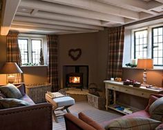 A wonderfully cosy living room. I just want to jump right in there and snuggle up in front of the fire...