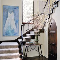 In the entryway to Stephen and Julie Block's Los Angeles home stands an antique Spanish table topped with a hand-painted Moroccan bowl and a vase for seasonal blooms. The painting, La Robe is by French artist Jean-Claude Hautin. French Dining Chairs, Vintage Dining Chairs, Antique Dining Tables, Family Room, Home And Family, Los Angeles Homes, House Entrance, House Painting, Painting Tips