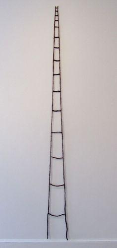 """Sonya Clark, """"Ladder"""", 2013, Human hair, 108 x 8 3/4 x 0.5 inches."""