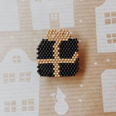 black and gold giftbox charm