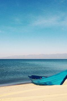 Blue Canoe on Sea Shore