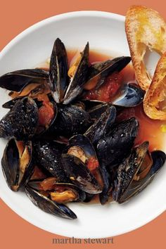 When time is really tight (and when isn't it?) the instant heat and sweetness of ready-made salsa come to the rescue! This satisfying mussel dinner is cooked in as long as it takes the wine and salsa to come to a boil, and the shellfish to steam open. #marthastewart #recipes #recipeideas #seafoodrecipes #seafooddinners #seafood Fish Recipes, Seafood Recipes, Dinner Recipes, How To Make Salsa, Seafood Boil, Mussels, Entrees, Curry, Easy Meals