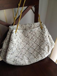 Amian Purse. Both English and Japanese versions are fully charted using standard knitting and/or crochet symbols.