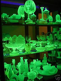 Depression era 'Vaseline' uranium glass. Beautiful display!