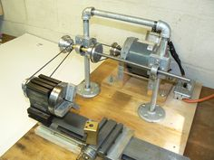 """Taig Jackshaft by Rob Kuhlman -- Homemade Taig lathe jackshaft constructed from 3/8"""" steel bar, pillow blocks, and 5/8"""" galvanized iron pipe fittings. Two Taig pulleys and a Gates belt are supported by pillow block-mounted, 0.375"""" I.D. Spiraflow bearings. http://www.homemadetools.net/homemade-taig-jackshaft"""