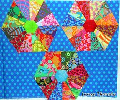 Neat block, and a really great tutorial. Love the bright colors, especially on that back ground.