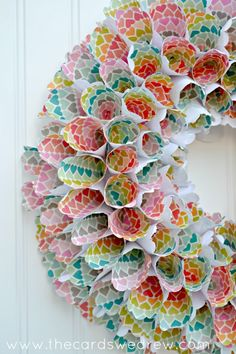 DIY rainbow cone wreath made from scrapbook paper-- party decoration idea