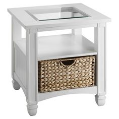 Glass-top end table in white with columninspired legs and a woven seagrass basket.   Product: End tableConstruction Mate...