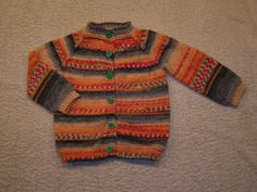 Knitted using multicoloured wool for socks for a 4 months old girl.