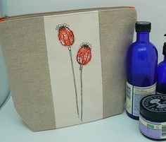 Pretty Poppy Seedhead, botanical free-machine embroidery applique wash-bag, with waterproof nylon lining by Moogsmum on Etsy Freehand Machine Embroidery, Machine Embroidery Applique, Orange Poppy, Sewing Projects, Sewing Ideas, Wash Bags, Handmade Bags, Vodka Bottle, Poppies