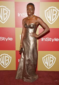 Danai Gurira, star of Walking Dead, offsets her striking gold gown with the black Alexia clutch. @Anna Lynch Magazine @Lisa.K.Bennett #Alexia #boxclutch #eveningbag