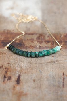 Row of raw, hand cut, rustic Emerald Beads have been strung to create a beautiful ombre effect from the darkest green to pale mint, set seamlessly in the centre of a 14K Gold Fill rolo chain. Also available in 925 Sterling Silver. Perfect for a May Birthday! Great for layering too! •Natural Emerald beads are 4-5mm •Sterling silver or 14K gold fill rolo chain and beads. Finished with a spring clasp closure in the chosen metal. •Available on 40cm/16 or 45cm/18 chain with spring clasp…