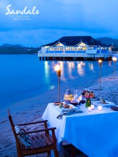 Candlelight dining on the beach is an unforgettable romantic experience. | Sandals Resorts | St. Lucia