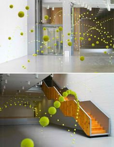 At first, these images appear to be multiple exposure photographs in which the motion of a ball has been captured in its arcs across gallery surfaces. But it's actual an installation, with hundreds of tennis balls hanging from strings to effectively capture a sense of movement
