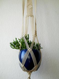Macrame plant hanger is made from beige, 3mm durable Polypropylene braided cord and wooden dowel. Wall hanging is 35 (90cm) long from the top loop to the end of the basket not including the tassel, and 6 inches (14 cm) wide. Wooden dowel is 11 inches long (27 cm). ****************