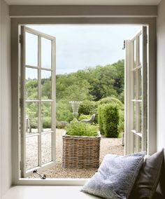 """A view of the garden from London designer Justin Van Breda and entrepreneur Alastair Matchett's country house in England's Cotswolds region. Interior Garden, Perfect World, Elle Decor, Windows And Doors, Outdoor Spaces, French Country, New Homes, Cottage, Van"