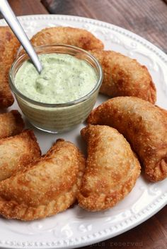 Recipe for langostino and Andouille sausage empanadas inspired by the flavors of Louisiana. These spicy empanadas can also be made with crawfish or shrimp, and are served with an avocado cilantro dipping sauce. Potato Appetizers, Chicken Appetizers, Appetizer Recipes, Spinach Cheese Puffs, Tomato And Cheese, Empanadas, Andouille Sausage Recipes, Chef Work, Savory Pastry