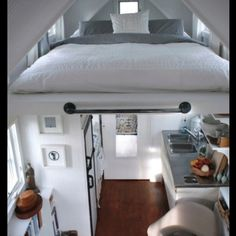 Bed Built Into Ceiling Above Kitchen