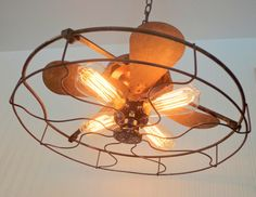 Our designer handcrafted this light using a variety of old metal components dating back to the early 1900s. Look at the incorporation of the original