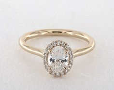 www.jamesallen.com mobile diamond-rings oval-cut-engagement-rings 0.90-carat-halo-engagement-ring-1773456