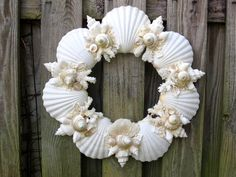 SEASHELL WREATH with white and pearled shells and coral. $145.00, via Etsy.