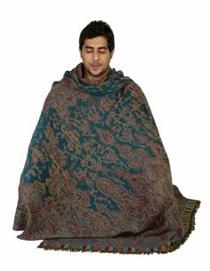 This large size (55 x 106 inches) shawl is meant for keeping yourself comfortable during prayers or meditation or yoga. When you are seated in meditation posture, you can cover yourself fully with this shawl. This shawl alternates very well, were you to use it as yoga blanket. The fabric is thick, almost like a blanket, yet much lighter. It is made in natural wool with beautiful paisley designs and patterns woven within the fabric. This shawl cum blanket looks elegant and is very func