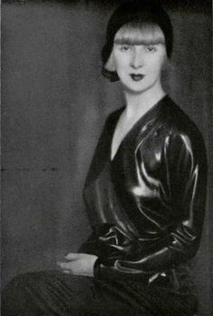 CAN ANYONE TELL ME WHAT THIS FABRIC IS? CIRE SATIN?? awesome wetlook .... Suzy Solidor, 1930